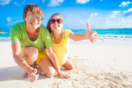 thumps up: remote tropical beaches and countries. travel concept