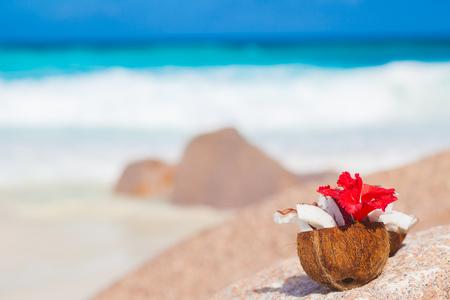 la digue: picture of fresh coconut juice on tropical beach. La Digue island, Seychelles