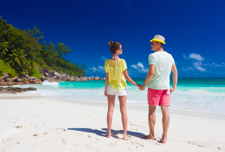 young family in love having fun at tropical Anse Goergette beach. Praslin, Seychelles Stock Photo