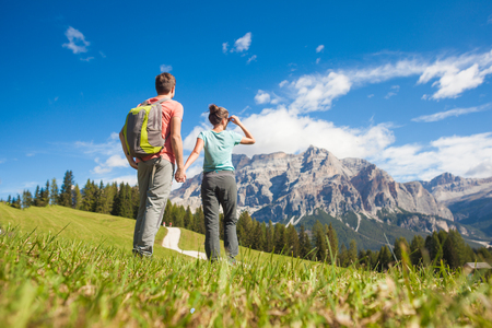Travelers hiking in breathtaking landscape of Dolomites Mounatins in summer in ALta Badia, Italy. Travel Lifestyle wanderlust adventure concept. Outdoor wilderness vacations. Banco de Imagens - 123949403