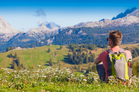 Hiker on the top of the mountains at Dolomites, South Tyrol. Italy, Europe Stock Photo - 123949689