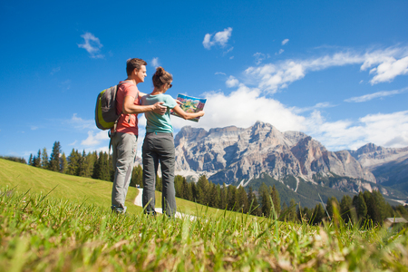 Travelers hiking in breathtaking landscape of Dolomites Mounatins in summer in ALta Badia, Italy. Stok Fotoğraf