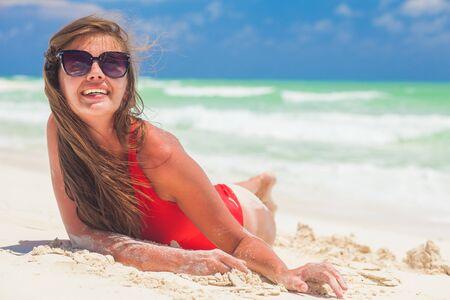 Young female enjoying sunny day on tropical beach Archivio Fotografico