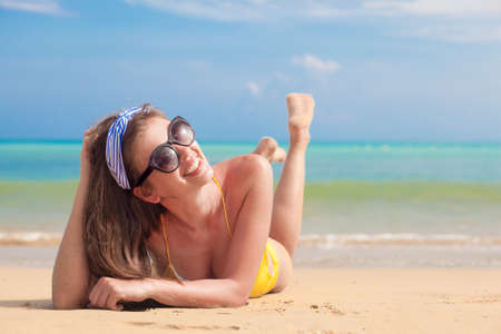 Beautiful woman sunbathing at the seaside 版權商用圖片