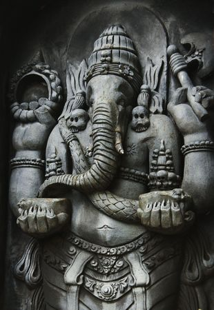 A statue of Ganesha, one of the Hindu Gods, carved in the style of Javanese art photo