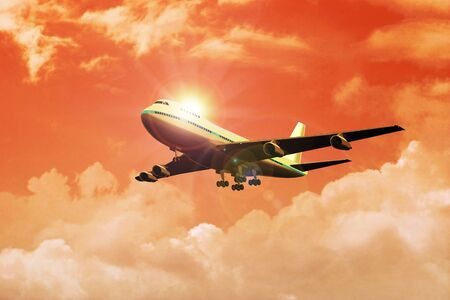 firmament: Stock image of an airplane flying during the sunset