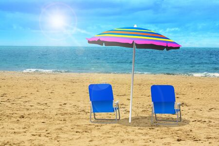 Two chairs at the beach photo