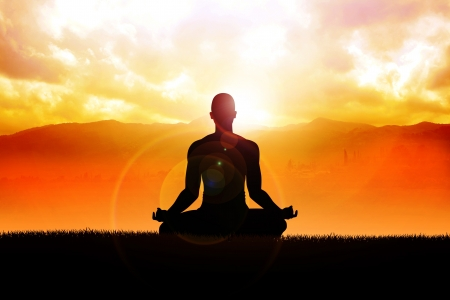 yoga sunset: Silhouette of a man figure meditating in the outdoors  Stock Photo