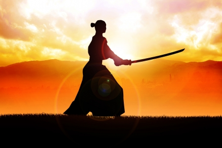 samurai warrior: Silhouette of a samurai posing during sunset