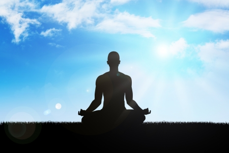 inner peace: Silhouette of a man figure meditating on the mountain