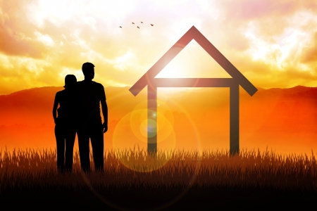 Conceptual image of young married couples with house icon photo