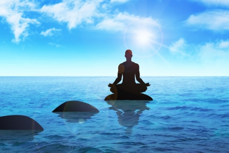 'peace of mind': Silhouette of a man figure meditating on a stone  Stock Photo