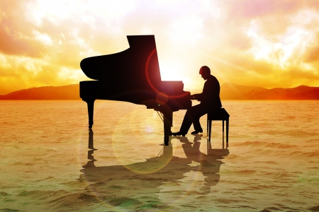Stock image of a man silhouette playing piano on the water