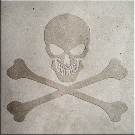 A jolly roger symbol embossed on concrete