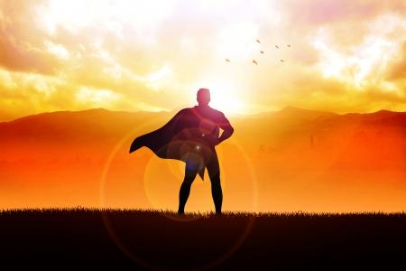 Silhouet illustratie van een superheld staande met uitzicht op de bergen als de achtergrond Stockfoto