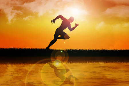 anatomy body: Silhouette of a sprinter at sunset Stock Photo