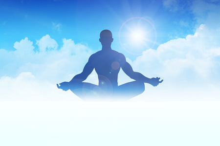 Silhouette of a man figure meditating on clouds photo