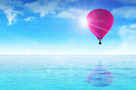 wade: An air balloon floating on blue water