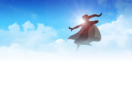 heroism: Silhouette of a female figure with hero suit flying on clouds Stock Photo
