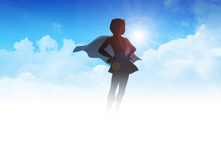 heroism: Silhouette of a female figure with hero suit on clouds