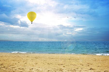 An air balloon flying on the ocean photo