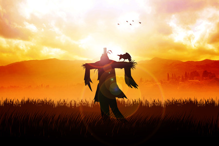 Silhouette of a scarecrow on a field photo