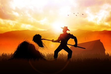Silhouette illustration of a farmer with a pitchfork collecting hay illustration