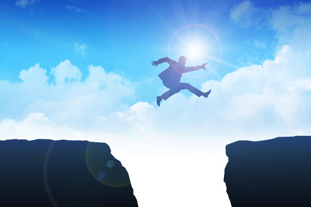 leap: Man jumping over the ravine