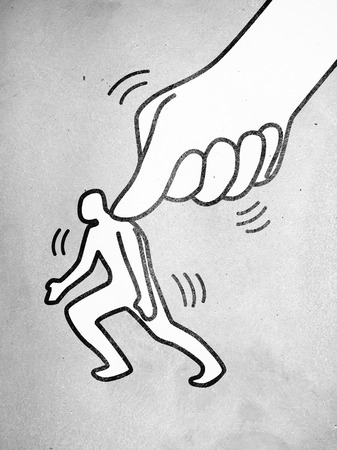 小さな男図を押す大きい親指のシンボル 写真素材