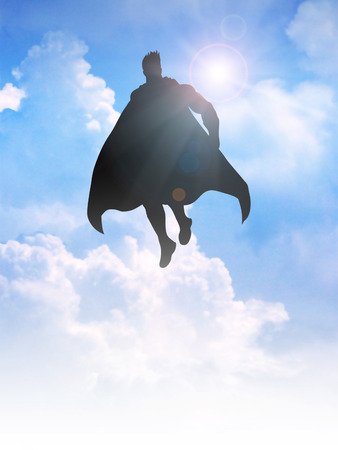 flying man: Silhouette of a superhero figure flying on clouds