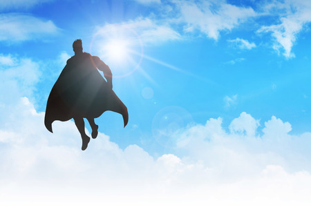 heroism: Silhouette of a superhero figure flying on clouds