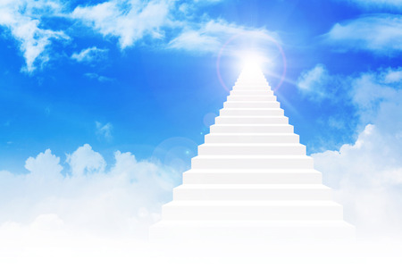 Stairway leading up to bright light above the sky