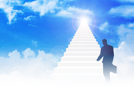 stairway to heaven: Silhouette of a man with suitcase step on to stairway leading up to bright light above the sky. Success, motivation, determination concept