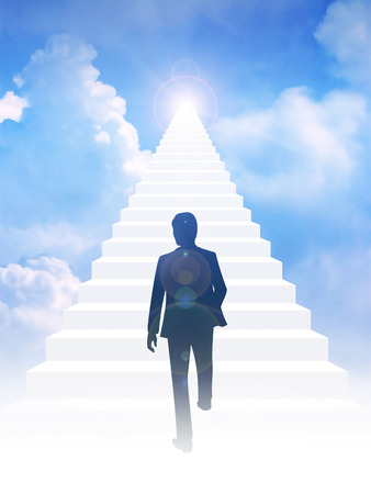 leading light: Silhouette of a man step on to stairway leading up to bright light above the sky. Success, motivation, determination concept
