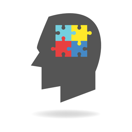 asperger: Human head silhouette with colorful jigsaw puzzle symbolizing autism Illustration