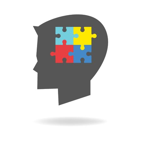 asperger: Children head silhouette with colorful jigsaw puzzle symbolizing autism