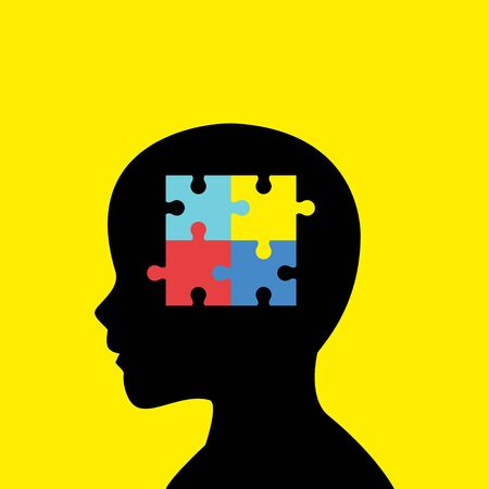 social awareness symbol: Children head silhouette with colorful jigsaw puzzle symbolizing autism