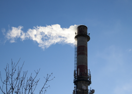 tall chimney: Smoke Stack and clear blue sky