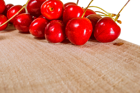 Fresh cherry on a wooden table