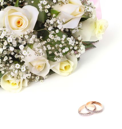 marital: wedding rings and roses bouquet