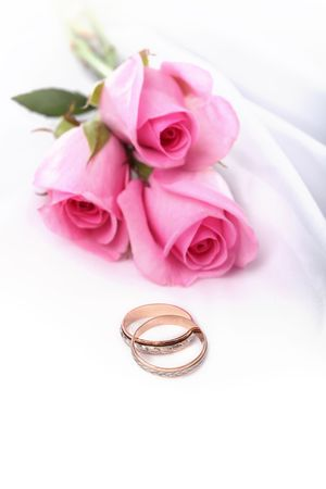 rose ring: wedding rings and pink roses  Stock Photo