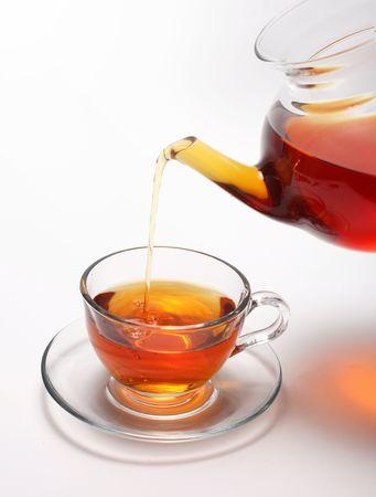 tea light: pouring tea to a teacup  Stock Photo