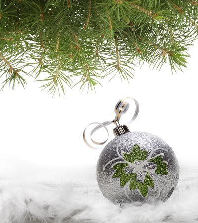 Christmas ball and green spruce branch photo
