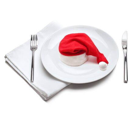 christmas dish: plate with red santa claus hat Stock Photo