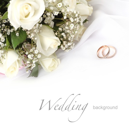 wedding rings and roses bouquet photo