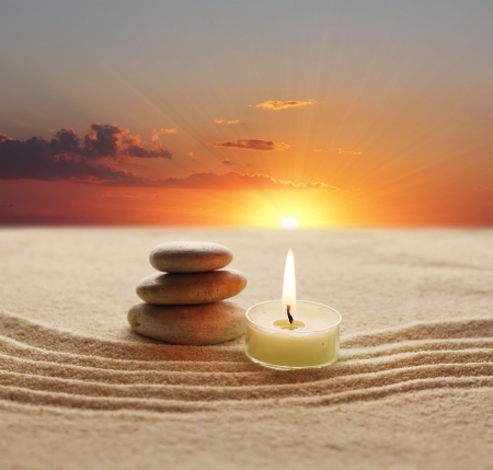 zen candles: stack of stones and candle light Stock Photo