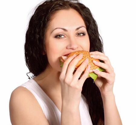 comiendo pan: mujer con hamburguesa Foto de archivo