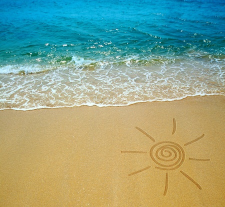 sun drawing on a beach Stock Photo - 9072275