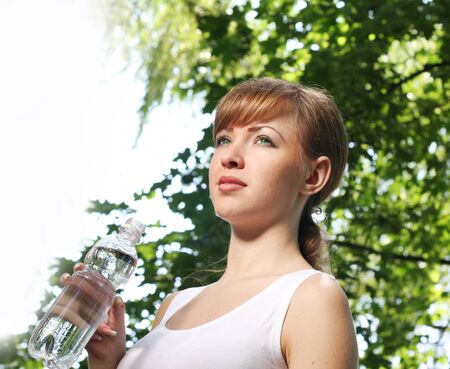 woman with water bottle  photo
