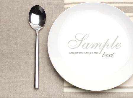 cubiertos de plata: cuchara y placa